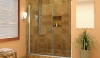 brown bathroom with frameless shower glass